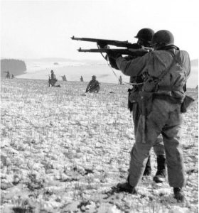 American infantry fire on the enemy near Bastogne, December 1944