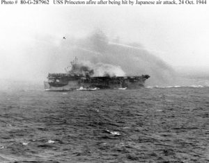 USS Princeton (CVL-23) burning, but still underway, about twenty minutes after she was hit by a Japanese air attack, 24 October 1944. Photographed from USS South Dakota (BB-57).  Official U.S. Navy Photograph, National Archives.