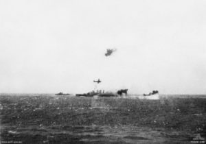 Joint Australian-United States naval Task Group 17.3 under air torpedo attack by Imperial Japanese Navy land-based bombers during the Battle of the Coral Sea on May 7, 1942. A Japanese Mitsubishi G4M Type 1 bomber flies past the cruiser HMAS Australia. The smoke astern of the cruiser marks where another Japanese bomber has been shot down. Date 7 May 1942