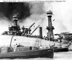 Men working onboard the USS Oklahoma on December 7th, 1941.