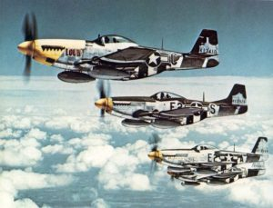 """The Bottisham Four"", a famous photo showing four U.S. Army Air Force North American P-51 Mustang fighters from the 375th Fighter Squadron, 361st Fighter Group, from RAF Bottisham, Cambridgeshire (UK), in flight on 26 July 1944."