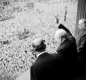 Churchill waves to crowds in Whitehall on the day he broadcast to the nation that the war with Germany had been won, 8 May 1945 Source: IWMCollections IWM Photo No.: H 41849