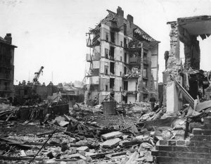 English: Damage Caused by V2 Rocket Attacks in Britain, 1945 Ruined flats in Limehouse, East London. Hughes Mansions, Vallance Road, following the explosion of the last German V2 rocket to fall on London, 27 March 1945. Date (Second World War)