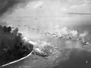 The first wave of LVTs moves toward the invasion beaches, passing through the inshore bombardment line of LCI gunboats. Cruisers and battleships are bombarding from the distance. The landing area is almost totally hidden in dust and smoke. Photographed from a USS Honolulu (CL-48) plane. Date September 15, 1944. Source  - National Park Service - (Naval Historical Center, US Navy 80-G-283553)