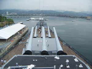 The USS Missouri (BB-63) watching over the sunken USS Arizona (BB-39) in Pearl Harbor.