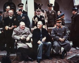 English: Yalta summit in February 1945 with (from left to right) Winston Churchill, Franklin Roosevelt and Joseph Stalin. Also present are USSR Foreign Minister Vyacheslav Molotov (far left); Field Marshal Alan Brooke, Admiral of the Fleet Sir Andrew Cunningham, RN, Marshal of the RAF Sir Charles Portal, RAF, (standing behind Churchill); George Marshall, Army Chief of Staff and Fleet Admiral William D. Leahy, USN, (standing behind Roosevelt). Date February 1945 Source  [1] The source web page include the following caption: Photo #: USA C-543 (Color)