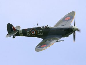 Spitfire LF Mk IX, MH434 being flown by Ray Hanna in 2005. This aircraft shot down an FW 190 in 1943 while serving with 222 Squadron RAF.