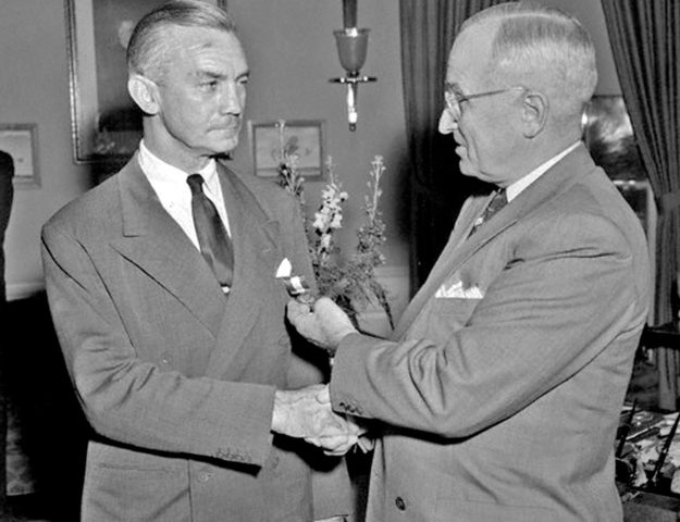 Forrestal receives a medal from President Truman